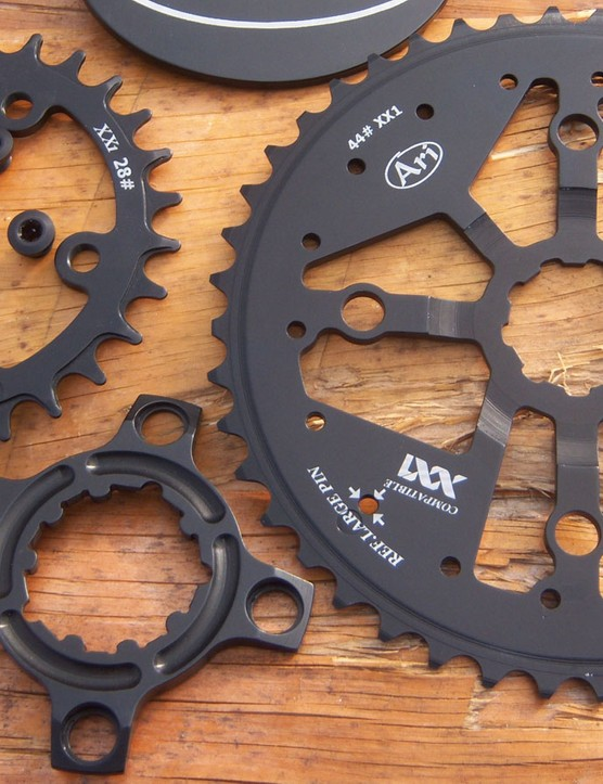 A mega-wide 44t Ari XX1 replacement cog with a little 28t wide-narrow ring
