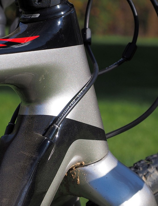 The cable ports on the down tube keep the lines tucked up close against the center of the bike but be sure to apply some protective tape to the head tube if you want to preserve the paint