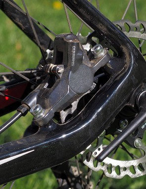 The rear brake caliper is nicely tucked away inside the rear triangle. Cable routing is smooth and clean