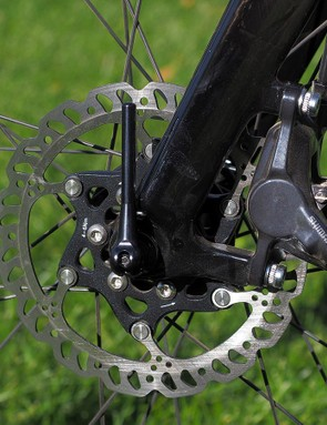 The front thru-axle is unquestionably lightweight but the tiny lever is a little awkward to use and the carbon fiber body doesn't slide in and out of the hub as nicely as it should
