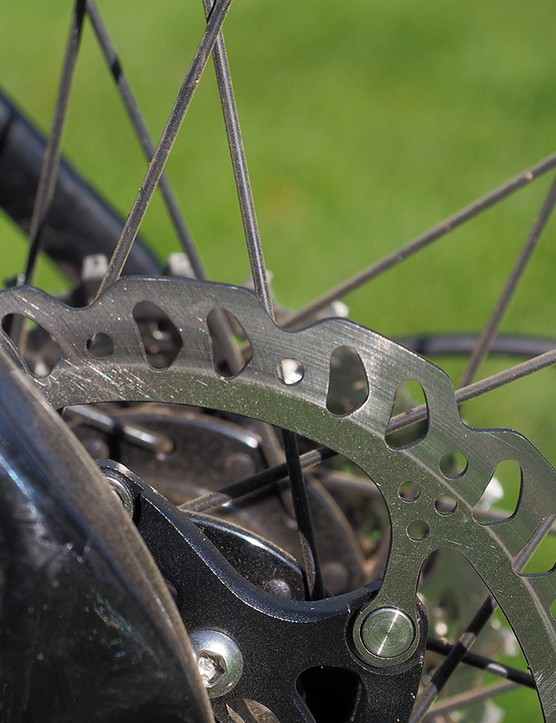 The metallic pads will last longer in wet or muddy conditions than organic ones but don't have as much bite as organic ones, especially when paired with 140mm-diameter rotors