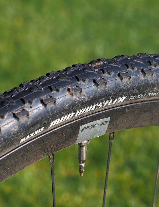 Despite appearances, the Maxxis Mud Wrestler tires roll surprisingly slowly and don't offer much grip except in softer ground where the knobs can really dig in. The Giant house-brand PX-2 wheels are heavy but set up tubeless easily