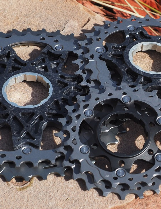 For the bigger cogs, titanium rings are attached with stainless steel rivets to carbon composite spiders, which in turn have co-molded aluminum centers to precisely mate to the freehub body. The middle cogs are attached to aluminum carriers while the smallest cogs are made from forged steel