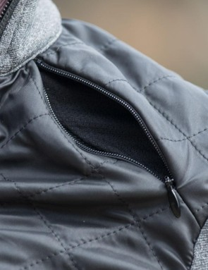 Zips on the shoulders assist with temperature regulation while maintaining the jacket's snug fit