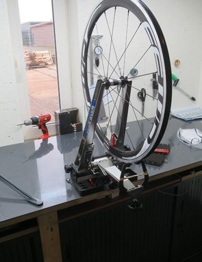 Master craftsman Roman Storcel has a clean, soundproofed room for his wheel-building development work