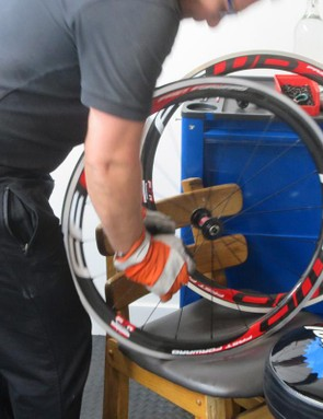 The spokes are stressed by hand, in between checking the wheels and tweaking the spoke tension