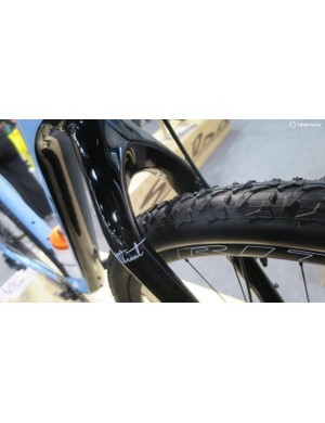 The carbon front fork offers similarly massive rubber 'n' mud room too