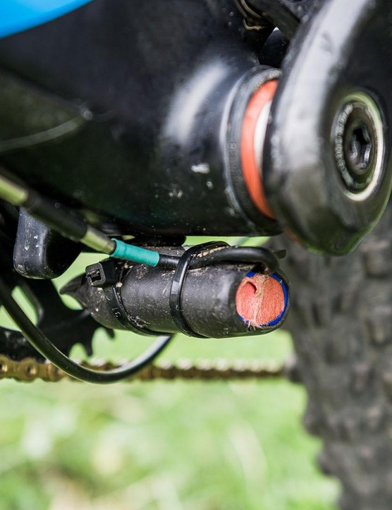 The E:I system is powered by a much smaller and lighter unit, mounted under the BB, than on consumer bikes. It only needs to provide enough juice for a day's racing, while customers need theirs to last longer