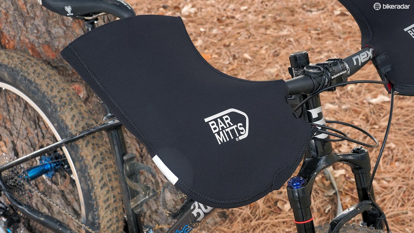 When it comes to keeping your hands warm in super cold temperatures, there's nothing better than Bar Mitts and similar products that wrap the entire handlebar grip area
