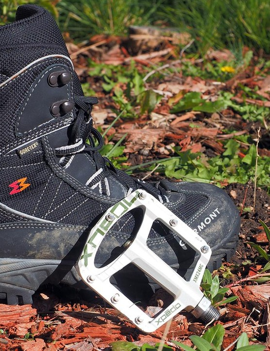 If it's really cold outside — or you just don't feel like spending the money on winter-specific cycling shoes — consider switching to flat pedals and just using your everyday winter hiking boots. They're heavier and clunkier, but effective nonetheless