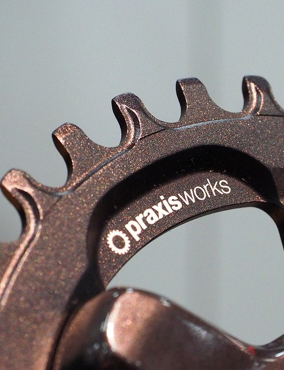 We've been impressed so far with Praxis's narrow/wide tooth profiles, which have proven to reliably hold on to the chain even in rough conditions