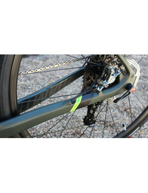 Hydraulic lines are neatly routed through the frame and fork