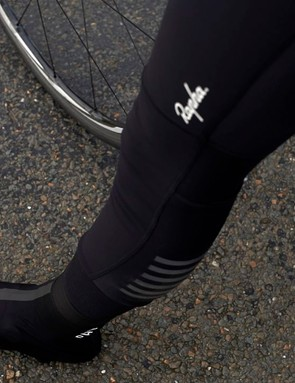 Subtle reflective detailing is included on the legs