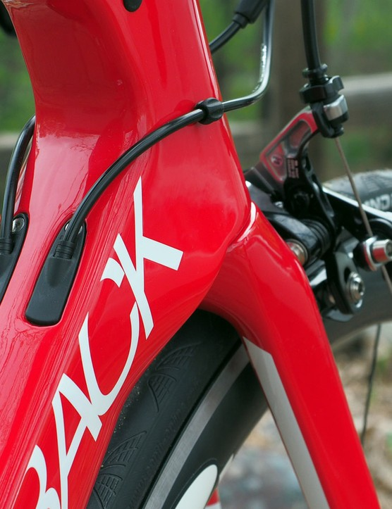 The flare at the base of the head tube area is intended to smooth airflow coming off of the front brake