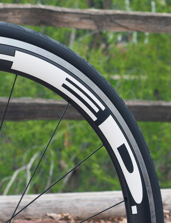 The HED Jet 4 clinchers are a bit heavier than full-carbon rims but they're wicked fast and offer better braking performance than any carbon rim could hope for