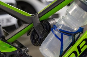 The ability to carry a 750ml water bottle is a big deal when racing, a spare tube holds it firm