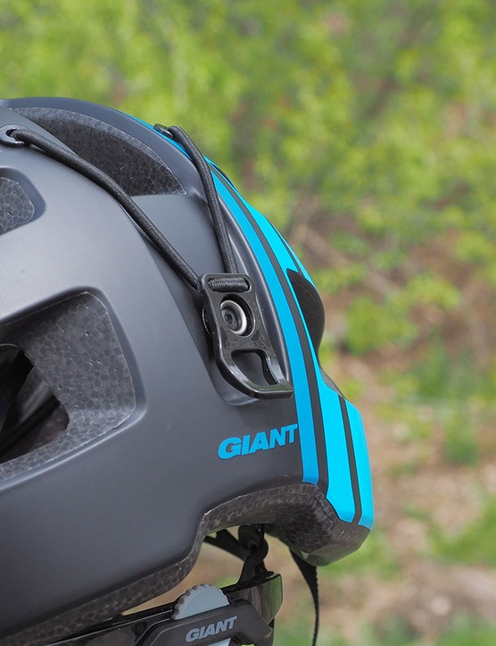 A goggle strap clip is built into the back of the shell
