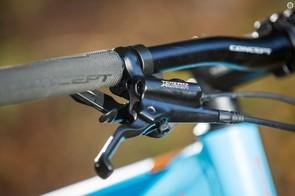 The narrow handlebar, nine-speed shifters and Tektro Auriga brakes limit proper off-road control