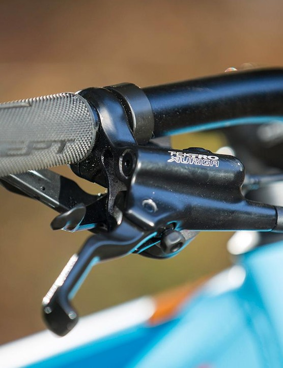 The narrow handlebar, nine-speed shifters and Tektro Auriga brakes limit proper off-road control