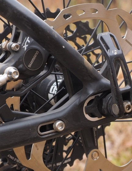The rear brake mount is thankfully integrated with the sliding dropout so you don't need to constantly readjust everything with every wheel change