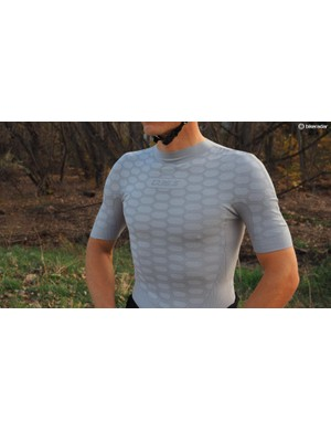 The base layer is made of a singular, tubular piece of fabric, which is sewn only at the shoulders