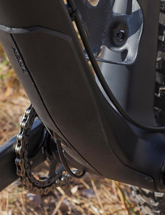 A molded guard protects the down tube from impacts