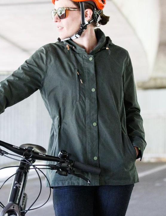 The women's Commuter Waxed Shell has a zip up front section rather than buttons alone, although the zip is a little fiddly to get started