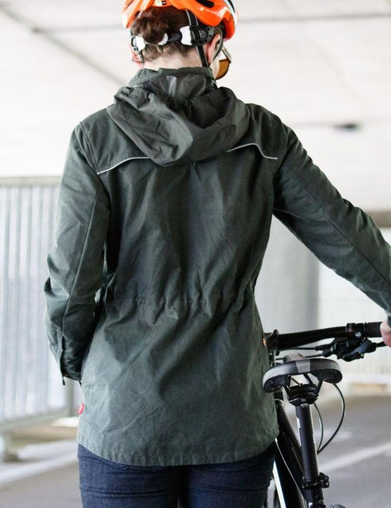 The waist of the women's Commuter Waxed Shell can be adjusted inward via an elastic draw cord on the inside for a stylish or more relaxed fit