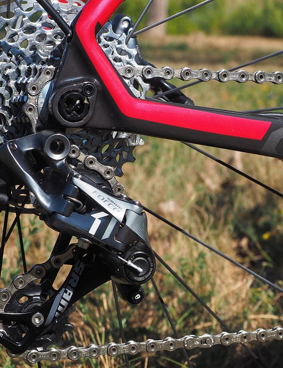 The SRAM Force 1 rear derailleur is a close cousin of the XX1 unit used by mountain bikers. A clutched pulley cage keeps the chain stable on bumpy terrain