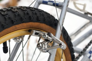 Wide-profile Shimano cantilevers clamped on to Araya anodized aluminum rims