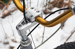 The stem clamp struggled to keep the tall bars from rotating under load