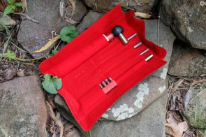 ... red felt lining adds a touch of class. While the roll up case keeps things compact and quick to use