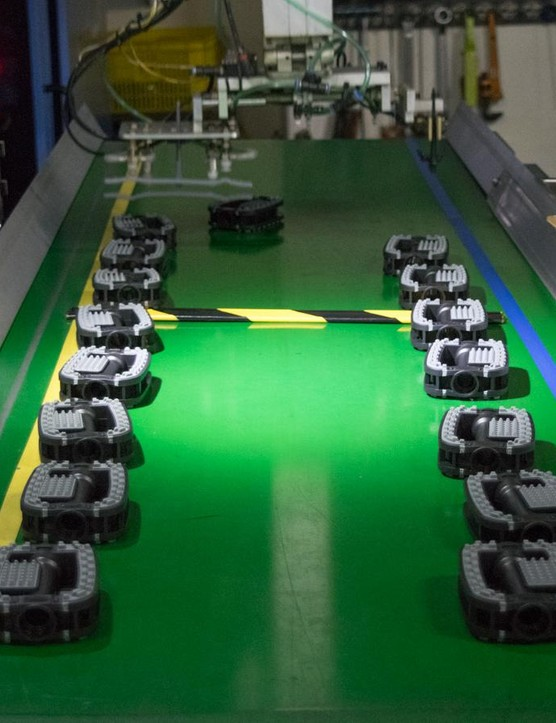 These pedals have just emerged from the injection moulding machine, which combines two separate plastics in a single operation