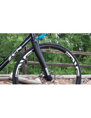 Disc brakes do add weight but much of that mass is down low. There's also (limited) potential to make rims lighter since they no longer have to act as a brake surface