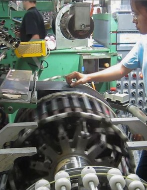 This is one process that involves real skill. It takes a worker around two minutes to assemble a tire, and that includes sticking the decals on