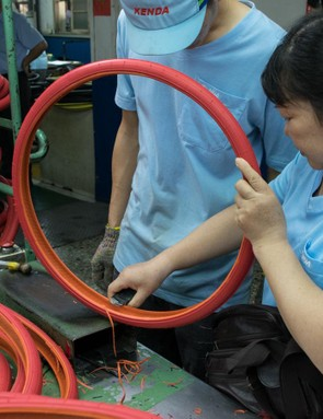 Molding flash (excess rubber) is removed by hand