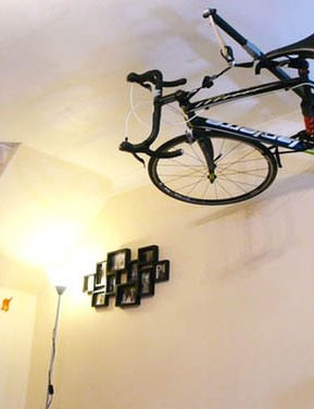 The Stowaway is a wall-mounted storage system that stows the bike above head height in a room or garage