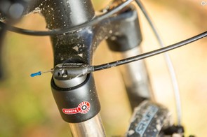 …but the non-adjustable coil spring leaves it feeling firm and short on travel