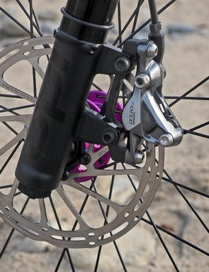 The fork sticks to old-school IS tabs for the disc brake caliper since you still need to loosen the bolts to pivot the caliper up and out of the way when removing the front wheel