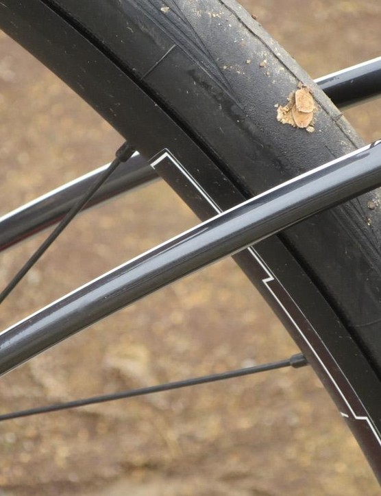 The non-drive-side stay sits much higher to allow for more disc caliper clearance