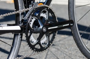 That compact crank is a square-tapered FSA unit. It's basic, but does exactly what it needs to