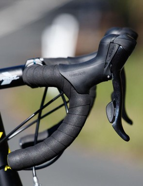 Handlebar shape has come a long way in recent years. A short reach and low drop make all the difference for those with poor flexbility (ie: most of us)