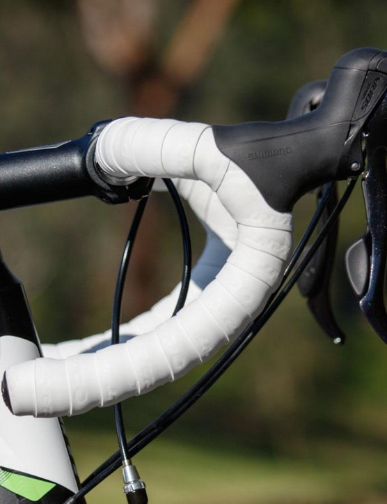 Giant's own alloy handlebar offers a comfortable shape. The bar tape is soft and comfortable, although don't expect it to stay white for long