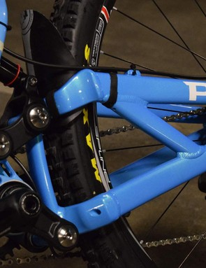 The lower link of the swingarm features a concentric pivot at the rear axle
