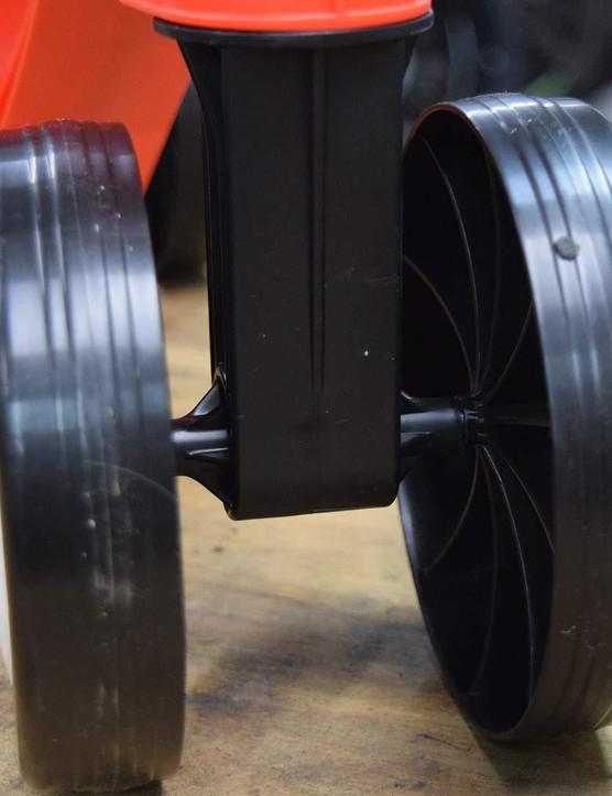 Two narrow plastic wheels rotate at each end via Steel axles