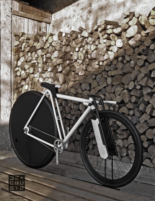 The unusual bike has a larger rear wheel and smaller front, with decorative aerofoils on the forks