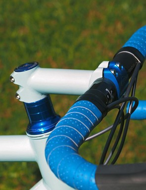 Engin Cycles offers custom stems, too. While some may be disappointed to see a fully custom bike with so many headset spacers, this setup retains the traditional stem angle many people prefer, plus the blue anodized spacers complement the baby blue paint perfectly. Somehow, this arrangement manages to look just right