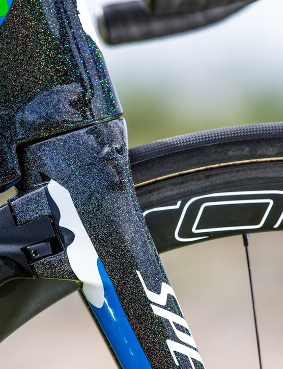 The front caliper acts as a fairing, extending the profile of the fork horizontally