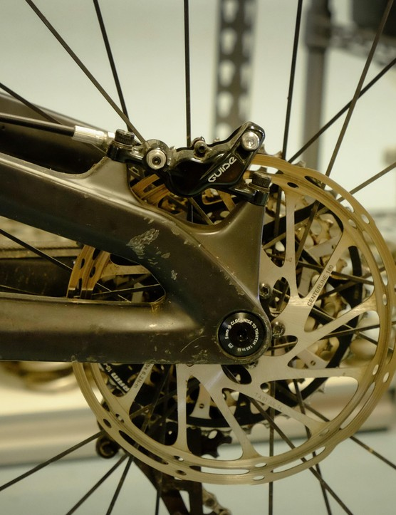 No adapters needed (and no small rotors accepted). The Wreckoning was designed with post-mount tabs for a 180mm rear rotor