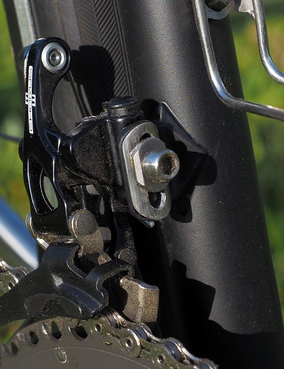 The front of the derailleur tab is left raw so the hardware doesn't mar the finish